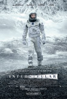 "Against a black backdrop, the title ""Interstellar"" is written downward and ends above a horizon that depicts a silhouette of farm buildings. The title starts with ""INTER"" in white letters, and a white flare effect from the horizon upward is behind ""STELLAR"" in black letters."