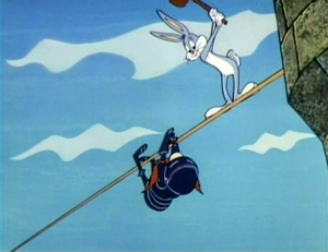 Knighty Knight Bugs - As Yosemite Sam climbs up the rope, Bugs Bunny, mallet in hand, prepares to knock Sam back down.