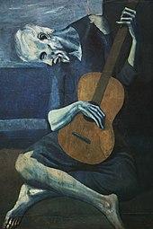blauer Mann beugte sich über eine Gitarre