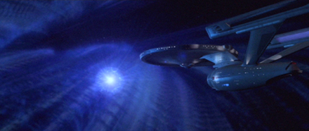 "Enterprise is attacked by V'Ger's ""whiplash bolt"" in a scene from the director's edition DVD. In the original feature the cloud was created by Trumbull's team, while the subcontracted Apogee under Dykstra created the bolt weapon. The model features Trumbull's system of self-illumination, and was shot fully lit, with the darker passes composited and burned in post-production. St1-enterprise and whiplash bolt.png"