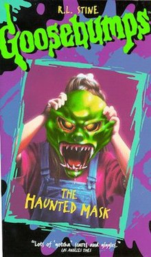 Cover art of the VHS, showing a girl holding a green Halloween mask over her face
