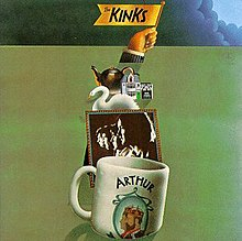 "The front cover artwork of the album. A white coffee mug with the word ""Arthur"" and a picture of two men sits in the foreground; a sepia-tone profile photo of the Kinks sits behind it; a swan and other small, various objects sit behind the photo. A hand raises a flag from behind the pileup, which reads ""The Kinks"". These objects sit on a green background, with the exception of the top border, which is covered by storm clouds."