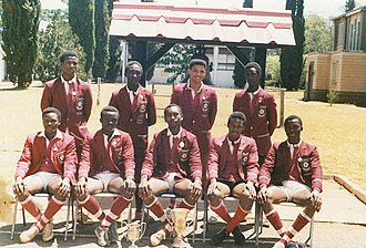 Lenana School - Lenana School 1988 7-a-side rugby squad poses for a team photo in front of the school bell which was recovered from HMS Duke of York (17).