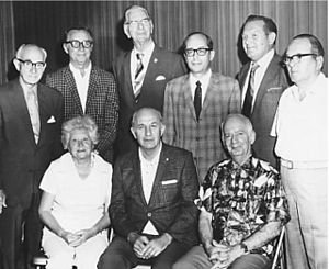 John J. Britt - Chairman of the Board John J. Britt, seated at right at the Hollywood Stamp Club (Florida). Seated center is president Uhle York with his wife Edith York. Standing are officers of the club (from left) Irwin Brown, Tom Bojanowski, unknown person, Benjamin Wishnietsky, Jerry Kedrierski, unknown person. (Florida c1975)