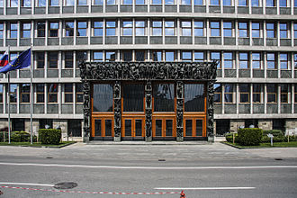 National Assembly Building of Slovenia - The main entrance with Kalin and Putrih's sculptures surrounding
