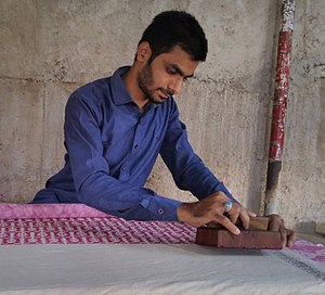 Textile printing - Mohammed Khatri working of Woodblock printing on Textile in Village Bagh, Madhya Pradesh, India.