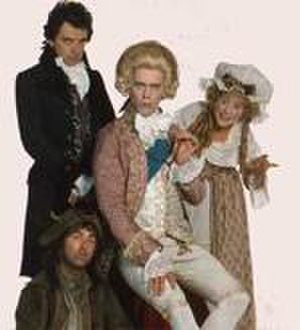 Blackadder the Third - The principal cast of Blackadder the Third in their Regency-styled costumes. Hugh Laurie (seated), Tony Robinson (bottom), Rowan Atkinson (standing) and Helen Atkinson-Wood