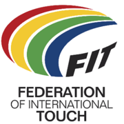 "Logo showing a multicolored, stylized, oval-shaped, football. Four approximately concentric crescent shapes (red, yellow, green and blue on a white or light-colored background) are used to form the top and left parts of the ball. The three black capital letters F, I and T (all slightly curved and on the same white or light-colored background) are used for the bottom-right of the ball. The words ""Federation of International Touch"" (split over three lines of text) are positioned below the stylized ball."