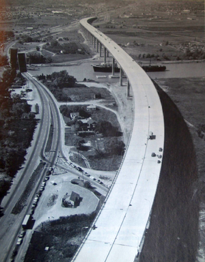 Garden City Skyway - The Garden City Skyway in September 1963, soon before opening. The old bridge lay to the left, raised for a passing ship. Traffic is queued on both sides, a frequent occurrence each summer until the skyway was built.
