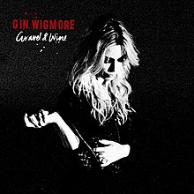 Black and white picture of Gin Wigmore, with a solid black background
