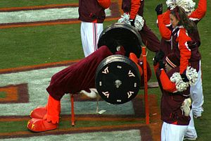 HokieBird - HokieBird bench presses the score in the endzone