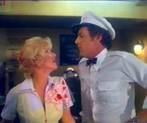 Human Highway - Charlotte (Charlotte Stewart) and milkman Earl Duke (David Blue) flirt. Blue died shortly before the film's release.