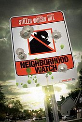 Red-and-white neighborhood-watch sign on a post