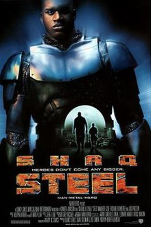 "An image of the film poster featuring a small silhouette of the characters Susan Sparks and John Henry Irons in the center. Encompassing the background is a larger image of John Henry Irons in his Steel outfit. The bottom of the image shows the words ""Shaq"" and ""Steel"" in large catch phrases ""Heroes Don't Come Any Bigger"" and ""Man Metal Hero"" in smaller print. The bottom of the poster showcases the rest of the cast in crew."