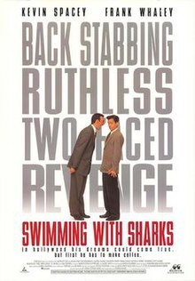 A man towering over another shouting, the words Swimming with Sharks filling the background