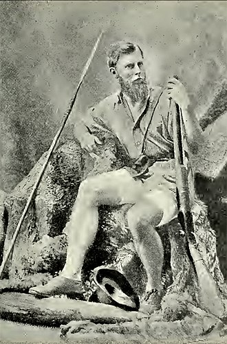 Frederick Selous - A studio portrait of young Selous with his Boer 4 bore elephant gun and African spear, 1870s.