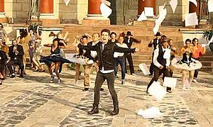 "Ambitions (song) - McElderry with backup dancers in his music video for ""Ambitions"""