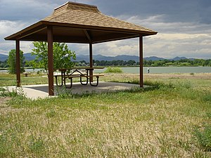 Crown Hill Park - ADA accessible picnic shelter, with ADA accessible fishing pier visible through table.