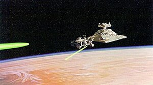 Tantive IV - The Star Destroyer Devastator chases the Tantive IV over Tatooine.
