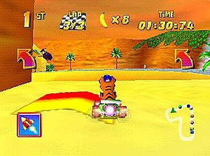 Diddy Kong Racing - In this screenshot, Timber the Tiger is racing in a desert-themed track. The interface displays the player's current position, number of laps, bananas, time, and a map of the track.