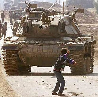 Faris Odeh - The iconic picture of Odeh throwing a stone at an Israel Defense Forces tank in the Gaza Strip, 29 October 2000