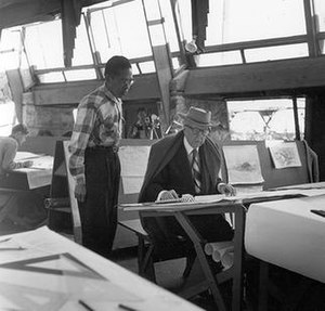 Ling Po and Frank Lloyd Wright in Taliesin West drafting room