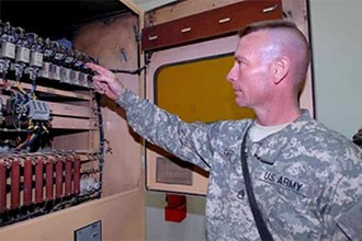 249th Engineer Battalion (United States) - Senior power plant operator, with the 1st Detachment, 249th Engineer Battalion, shows the circuits located at a substation on Logistical Support Area Anaconda, which is found in various areas located around the base that steps the power down to levels used in offices and trailers.