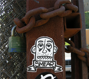 Sticker art - A sticker by Smear photographed in Los Angeles in 2006