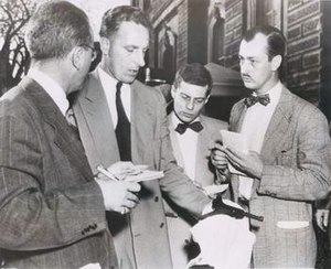 Vincent Mroz - Mroz displays the Luger pistol used in attempted assassination of Harry Truman. Press photo by Acme Photos.