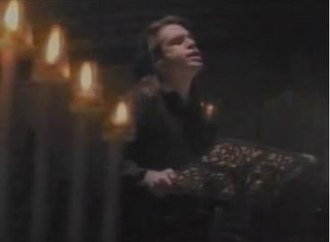 """Superman's Song - Brad Roberts singing in the music video for """"Superman's Song""""."""