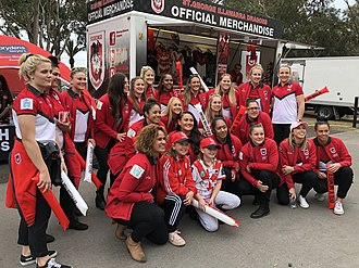 NRL Women's Premiership - Members of the St. George Illawarra Dragons NRL Women's team assemble outside Jubilee Oval during a promotional appearance in August 2018.