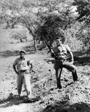 Frank Sturgis - Sturgis, with a 26 of July Movement armband, stands on a mass grave of 71 Batista supporters that he helped execute on San Juan Hill on Jan. 11, 1959.
