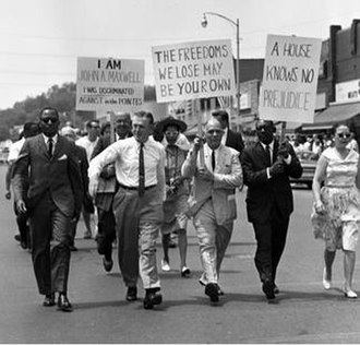 George W. Romney - The governor (shirt sleeves) walking in the first rank of an NAACP march, 600-strong, in protest of housing discrimination, June 1963