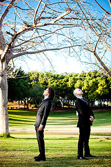 "Hagai Izenberg and Itai Simon of ""Rendezvous"", under a tree in a park.jpg"