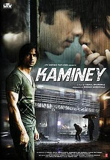 The poster depicting a man holding a gun, a couple having a romantic moment and raining on a street with a dark colour scheme. Text at the top of the poster reveals the title. While, text at the bottom of the poster reveals production credits.