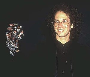Tod Machover - Tod Machover of MIT Media Lab demonstrated the sound-creating Hyper-Glove while conducting musicians at the 1990 CyberArts International festival.