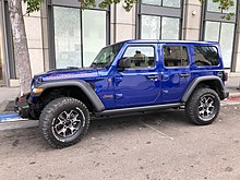 jeep wrangler unlimited rubicon with color-keyed fiberglass roof