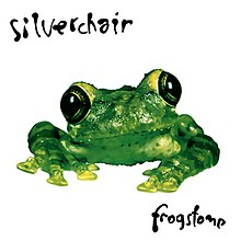 A photo of a green frog in front of a white background with Silverchair written above and Frogstomp written below it in a handwritten-style font