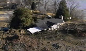 Kingston Fossil Plant coal fly ash slurry spill - A collapsed house inundated by the spill.