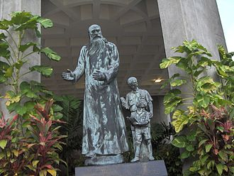 Catholic High School, Singapore - Sculpture of Rev. Father Edward Becheras in front of the clock tower