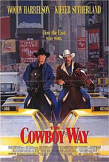 Two cowboys on horseback stuck in New York city traffic