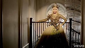 Freedom (Nicki Minaj song) - Minaj wearing a gold gown with a cross.