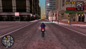 Grand Theft Auto: Liberty City Stories - Toni on Staunton Island riding a PCJ-600 motorcycle with a sub-machine gun equipped and with a two-star wanted level.