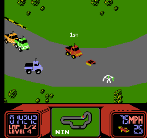 "R.C. Pro-Am - The player, represented by the red truck in the center, leads the race while about to collect a ""bonus letter"" and a roll cage."