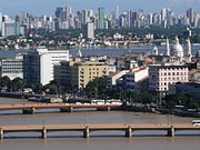 The famous Capibaribe River, bridges, Downtown and Boa Viagem Neighborhood at back.