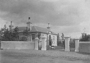 Gatepost - A view of the Lodge at Robertland with four gateposts. Circa 1930.