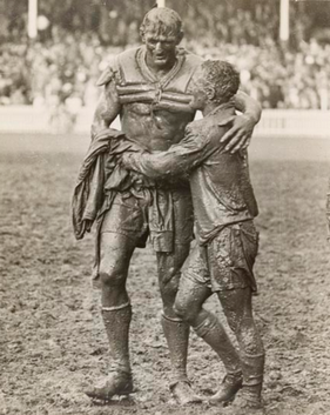 """1963 NSWRFL season - """"The Gladiators"""", John O'Gready's famous photograph of the two opposing captains, Norm Provan and Arthur Summons, taken after the match."""