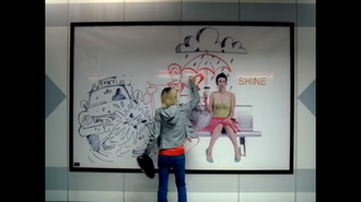 Bad Day (Daniel Powter song) - In this scene, the woman (Samaire Armstrong) is completing a heart on a billboard. In the past scenes, she was using a black marker to deface it with negativeness, while the man (Jason Adelman) used a red one to give it a positive tone.