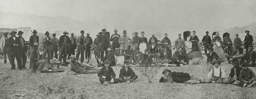 Brigham Young (seated near the middle, wearing a tall beaver hat) and an exploring party camped at the Colorado River in 1870 Brigham Young and company 1870.PNG