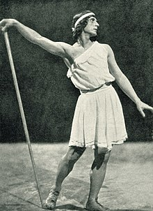 male ballet dancer in ancient Greek costume striking a pose